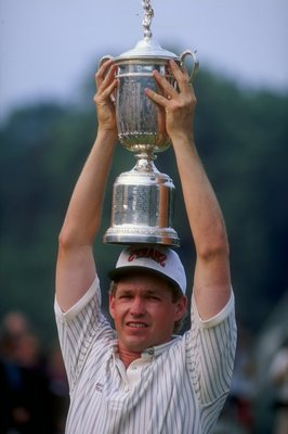 Lee Janzen of the USA holds the trophy over his head after winning the 1993 U.S. Open at the Batusrol Golf Club in Springfield, New Jersey.