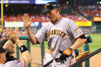 ST. LOUIS, MO - JUNE 2: Aubrey Huff #17 of the San Francisco Giants is congratulated by teammates after hitting a two-run home run against the St. Louis Cardinals at Busch Stadium on June 2, 2011 in St. Louis, Missouri.  (Photo by Dilip Vishwanat/Getty Im