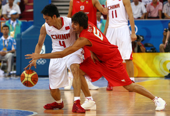 BEIJING - AUGUST 12:  (R-L) Ricky Rubio #6 of Spain attempts to steal the ball from Chen Jianghua #4 of China in the preliminary basketball game held at the Beijing Olympic Basketball Gymnasium during Day 4 of the Beijing 2008 Olympic Games on August 12,