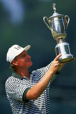 OAKMONT - 20 JUNE:  Ernie Els of South Africa lifts the trophy after victory in the US Open at Oakmont Country Club in Pennsylvania, USA on June 20, 1994. (photo by David Cannon/Getty Images)