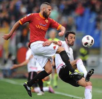 ROME, ITALY - APRIL 16:  Jeremy Menez (L) of Roma and Mattia Cassani of Palermo compete for the ball during the Serie A match between AS Roma and US Citta di Palermo at Stadio Olimpico on April 16, 2011 in Rome, Italy.  (Photo by Tullio M. Puglia/Getty Im