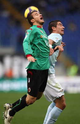 ROME - NOVEMBER 29:  Pablo Daniel Osvaldo of Bologna FC and Alexander Kolarov of SS Lazio in action during the Serie A match between Lazio and Bologna at Stadio Olimpico on November 29, 2009 in Rome, Italy.  (Photo by Paolo Bruno/Getty Images)