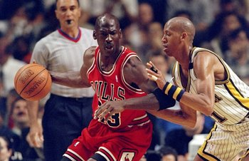 25 May, 1998:  Michael Jordan #23 of the Chicago Bulls dribbles as Reggie Miller #31 of the Indianapolis Pacers guards during the NBA Eastern Conference Finals at the Market Square Arena in Indianapolis, Indiana.  The Pacers defeated the Bulls 96-94. Mand