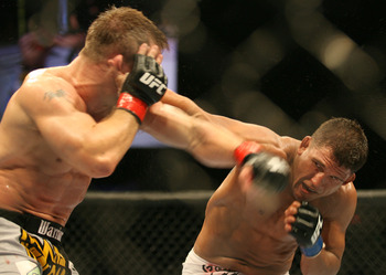 CHICAGO- OCTOBER 25: Sean Sherk (L) punches Tyson Griffin in a Lightweight bout at UFC's Ultimate Fight Night at Allstate Arena on October 25, 2008 in Chicago, Illinois. (Photo by Tasos Katopodis/Getty Images)