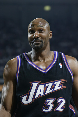 SACRAMENTO, CA - APRIL 19:  Karl Malone #32 of the Utah Jazz smiles during Game one of the Western Conference Quarterfinals against the Sacramento Kings during the 2003 NBA Playoffs at Arco Arena on April 19, 2003 in Sacramento, California.  The Kings won