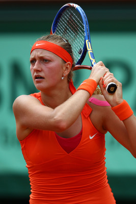 PARIS, FRANCE - MAY 30:  Petra Kvitova of Czech Republic hits a forehandduring the women's singles round four match between Na Li of China and Petra Kvitova of Czech Republic on day nine of the French Open at Roland Garros on May 30, 2011 in Paris, France
