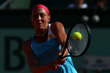 PARIS, FRANCE - MAY 28:  Yanina Wickmayer of Belgium hits a backhand during the women's singles round three match between Yanina Wickmayer of Belgium and Agnieszka Radwanska of Poland on day seven of the French Open at Roland Garros on May 28, 2011 in Par