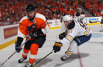 PHILADELPHIA, PA - APRIL 14: Tyler Myers #57 of the Buffalo Sabres checks Jeff Carter #17 of the Philadelphia Flyers in Game One of the Eastern Conference Quarterfinals during the 2011 NHL Stanley Cup Playoffs at Wells Fargo Center on April 14, 2011 in Ph