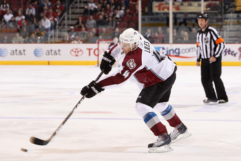 GLENDALE, AZ - APRIL 01:  John-Michael Liles #4 of the Colorado Avalanche passes the puck during the NHL game against the Phoenix Coyotes at Jobing.com Arena on April 1, 2011 in Glendale, Arizona.  The Avalanche defeated the Coyotes 4-3 in an overtime sho