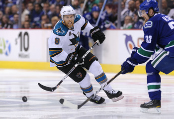 VANCOUVER, CANADA - MAY 24:  Joe Pavelski #8 of the San Jose Sharks pursues the puck as Henrik Sedin #33 of the Vancouver Canucks tries to defend the play in the third period in Game Five of the Western Conference Finals during the 2011 Stanley Cup Playof