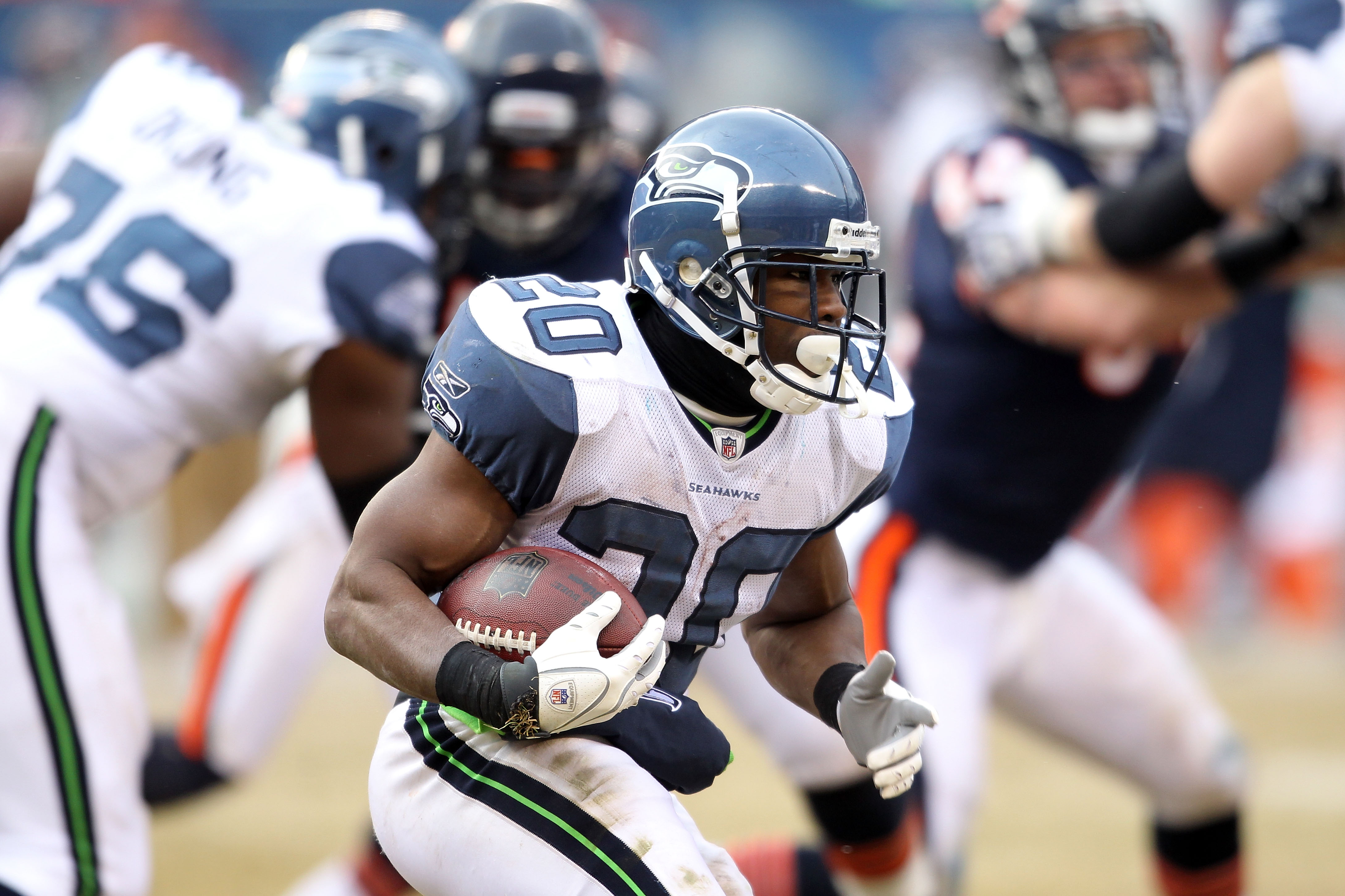 CHICAGO, IL - JANUARY 16:  Justin Forsett #20 of the Seattle Seahawks carries the ball against the Chicago Bears in the 2011 NFC divisional playoff game at Soldier Field on January 16, 2011 in Chicago, Illinois.  (Photo by Andy Lyons/Getty Images)