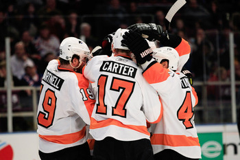 NEW YORK, NY - FEBRUARY 20:  Jeff Carter #17 of the Philadelpia Flyers is congratulated by his teammates for his first period goal against the New York Rangers at Madison Square Garden on February 20, 2011 in New York City.  (Photo by Chris Trotman/Getty