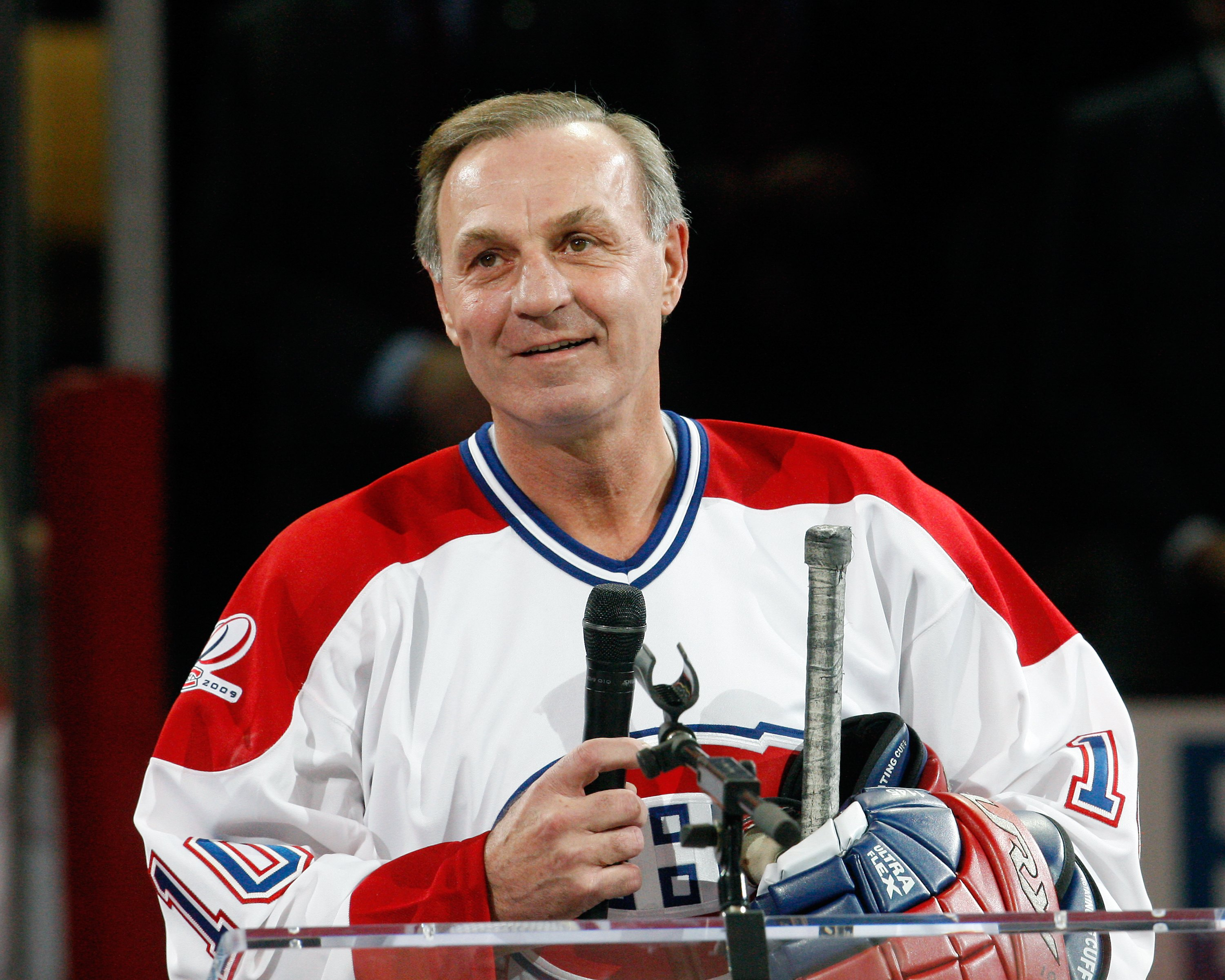 MONTREAL- DECEMBER 4:  Former Montreal Canadien Guy Lafleur speaks to fans during the Centennial Celebration ceremonies prior to the NHL game between the Montreal Canadiens and Boston Bruins on December 4, 2009 at the Bell Centre in Montreal, Quebec, Cana