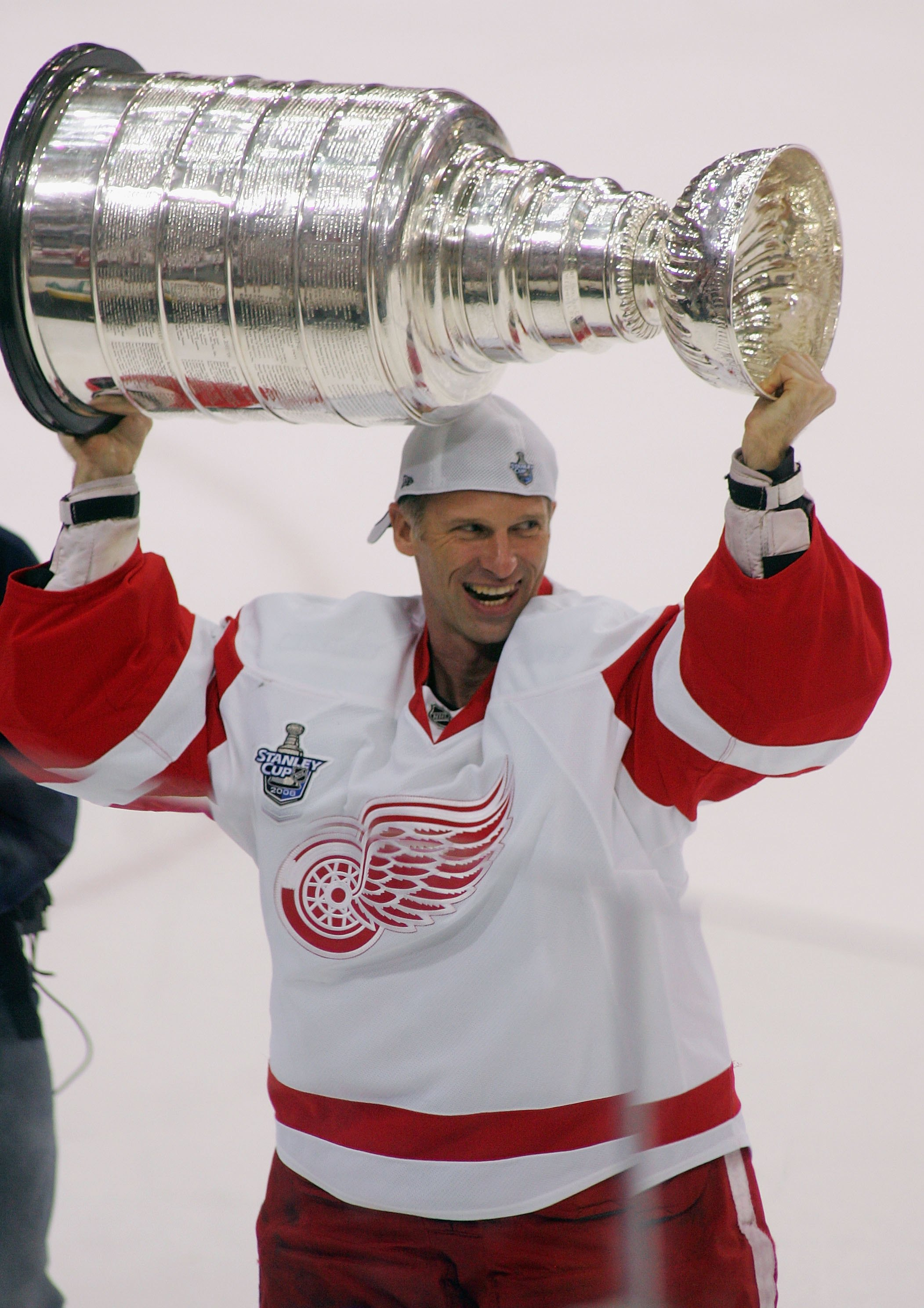 PITTSBURGH - JUNE 04:  Dominik Hasek #39 of the Detroit Red Wings celebrates with the Stanley Cup after defeating the Pittsburgh Penguins in game six of the 2008 NHL Stanley Cup Finals at Mellon Arena on June 4, 2008 in Pittsburgh. Pennsylvania. The Red W