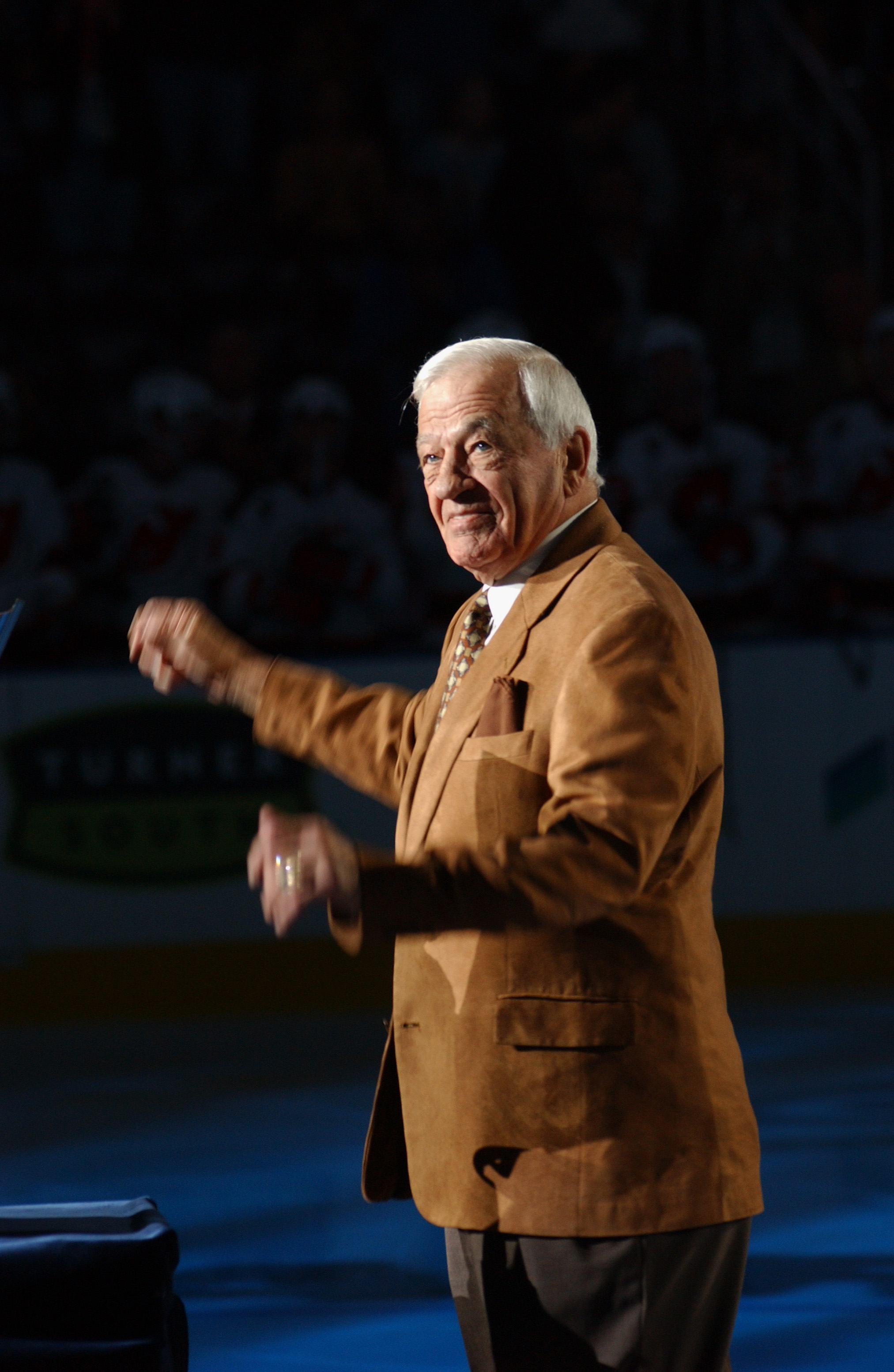 ATLANTA - OCTOBER 22:  Hockey legend Bernie 'Boom Boom' Geoffrion acknowledges the crowd after being introduced before the Atlanta Thrashers game against the New Jersey Devils on October 22, 2005 at Philips Arena in Atlanta, Georgia. The Thrashers won the