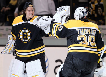 BOSTON, MA - APRIL 23:  Tuukka Rask #40 of the Boston Bruins congratulates Tim Thomas #30 after the game against the Montreal Canadiens after Game Five of the Eastern Conference Quarterfinals during the 2011 NHL Stanley Cup Playoffs at TD Garden on April