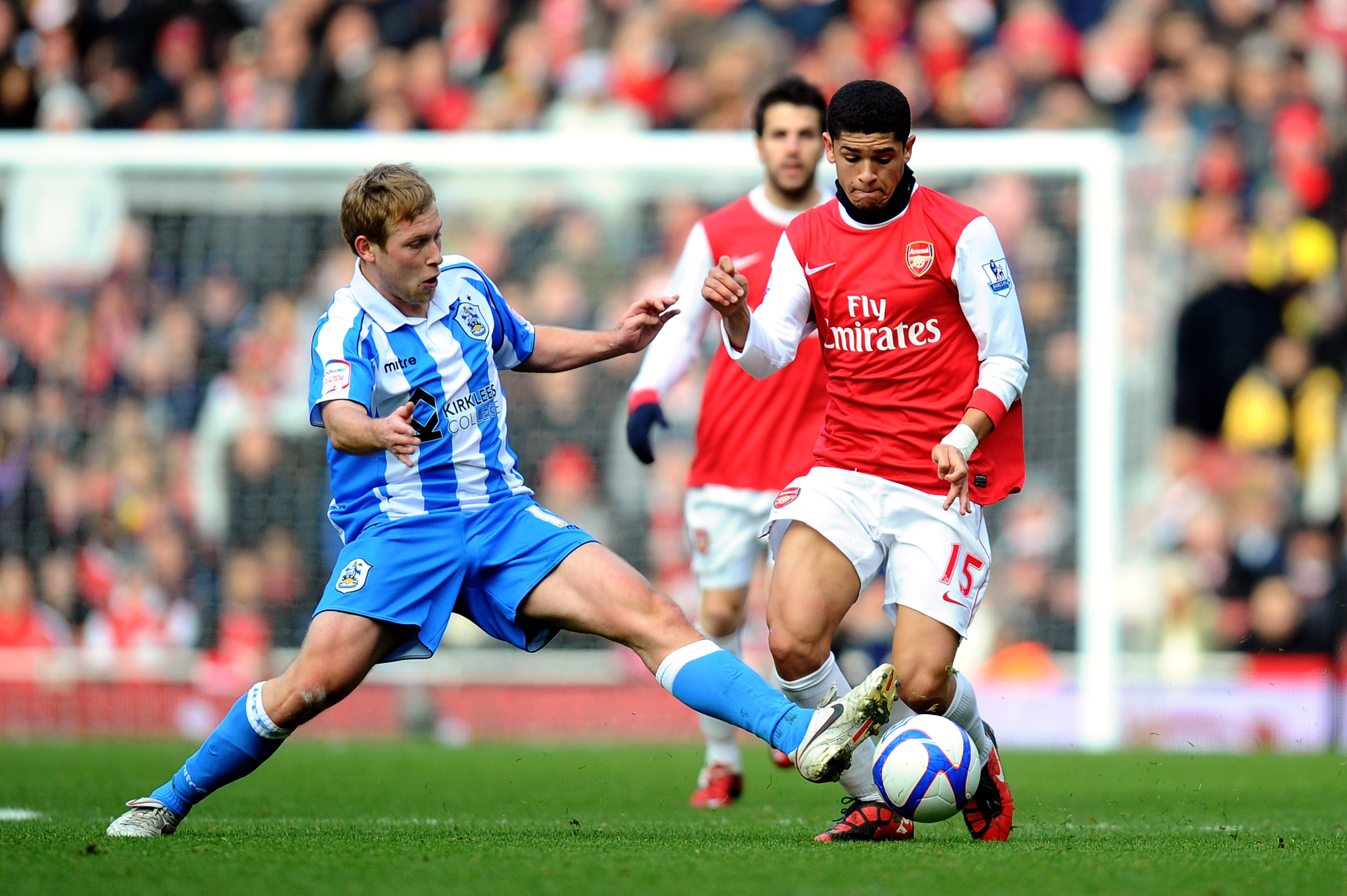 LONDON, ENGLAND - JANUARY 30:  Denilson of Arsenal is tackled by Scott Arfield of Huddersfield during the FA Cup sponsored by E.ON fourth round match between Arsenal and Huddersfield Town at The Emirates Stadium on January 30, 2011 in London, England.  (P