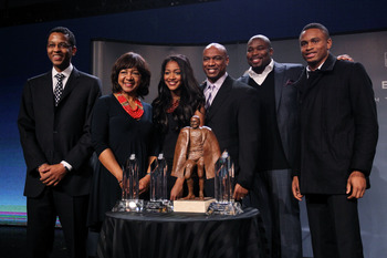 DALLAS, TX - FEBRUARY 04:  Walter Payton NFL Man of the Year Award finalists Nnamdi Asomugha (R) of the Oakland Raiders and Israel Idonije (2ndR) of the Chicago Bears pose with the Peyton family, Connie Payton (2ndL), wife of former Chicago Bears great Wa