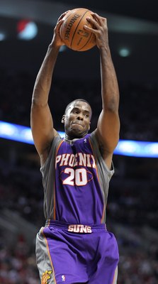 PORTLAND, OR - APRIL 29:  Jarron Collins #20 of the Phoenix Suns rebounds against the Portland Trail Blazers during Game Six of the Western Conference Quarterfinals of the NBA Playoffs on April 29, 2010 at the Rose Garden in Portland, Oregon. The Suns def