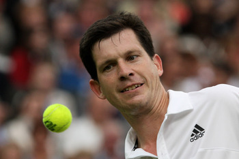LONDON, ENGLAND - MAY 17:  Tim Henman watches the ball during the Mens Singles match against Andre Agassi  during the 'Centre Court Celebration' at Wimbledon on May 17, 2009 in London, England.  (Photo by Hamish Blair/Getty Images)