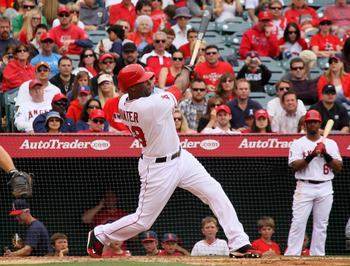 ANAHEIM, CA - MAY 22:   Torii Hunter #48 of the Los Angeles Angels of Anaheim hits a two run home run in the fouth inning against the Atlanta Braves on May 22, 2011 at Angel Stadium in Anaheim, California.   The Angels won 4-1.  (Photo by Stephen Dunn/Get