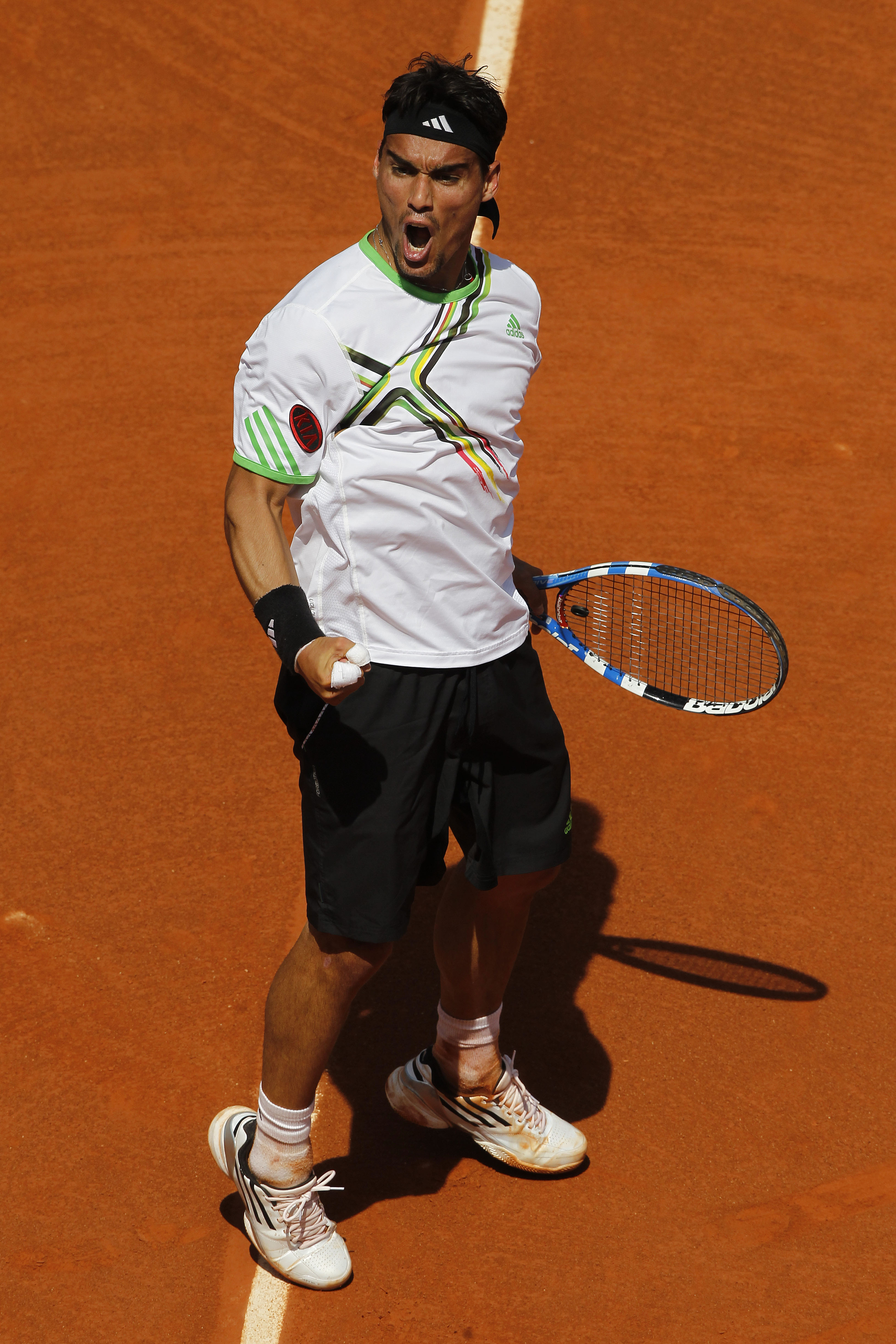 PARIS, FRANCE - MAY 29:  Fabio Fognini of Italy celebrates a break point during the men's singles round four match between Fabio Fognini of Italy and Albert Montanes of Spain on day eight of the French Open at Roland Garros on May 29, 2011 in Paris, Franc