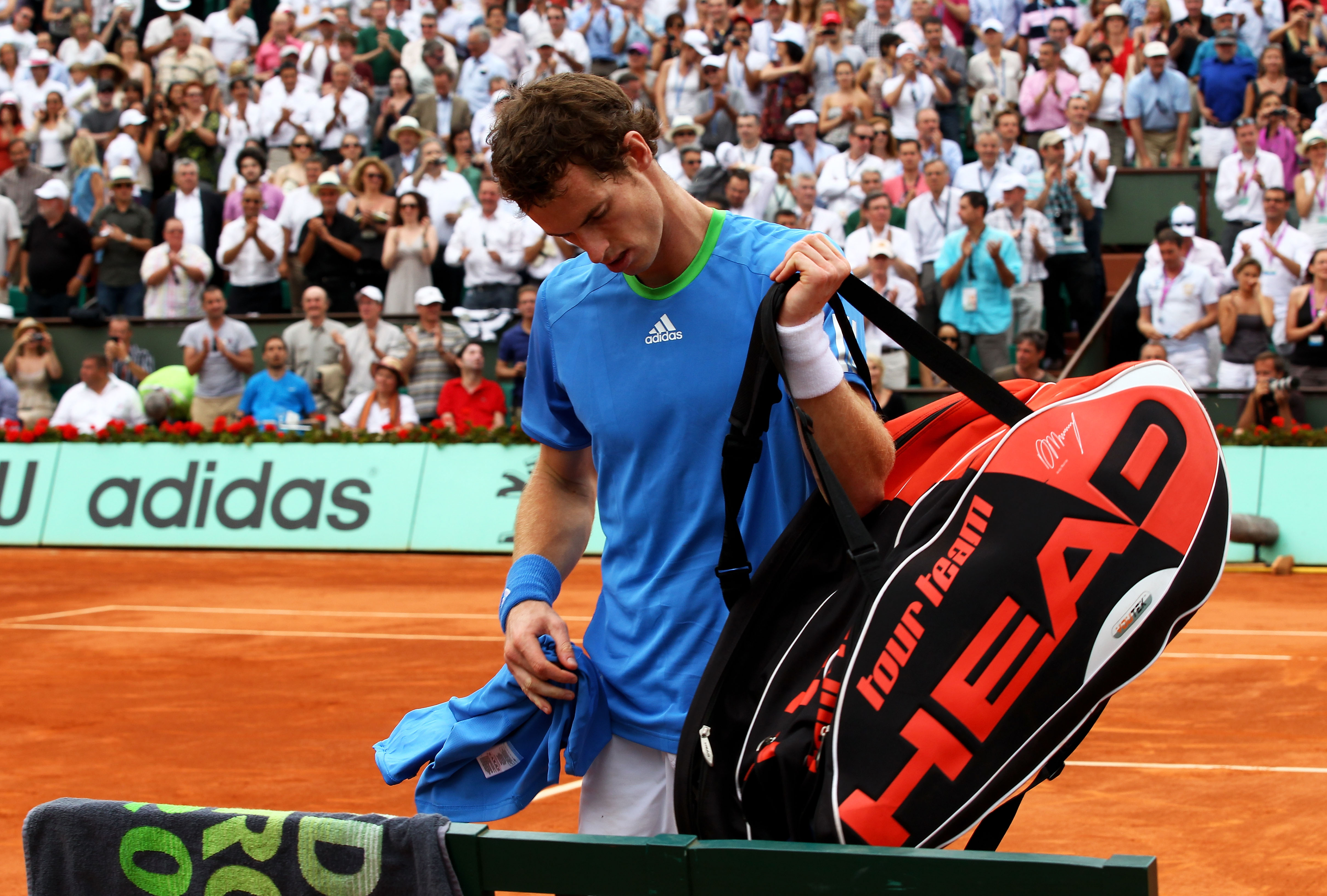PARIS, FRANCE - JUNE 03:  Andy Murray of Great Britain leaves the court following his defeat during the men's singles semi final match between Rafael Nadal of Spain and Andy Murray of Great Britain on day thirteen of the French Open at Roland Garros on Ju