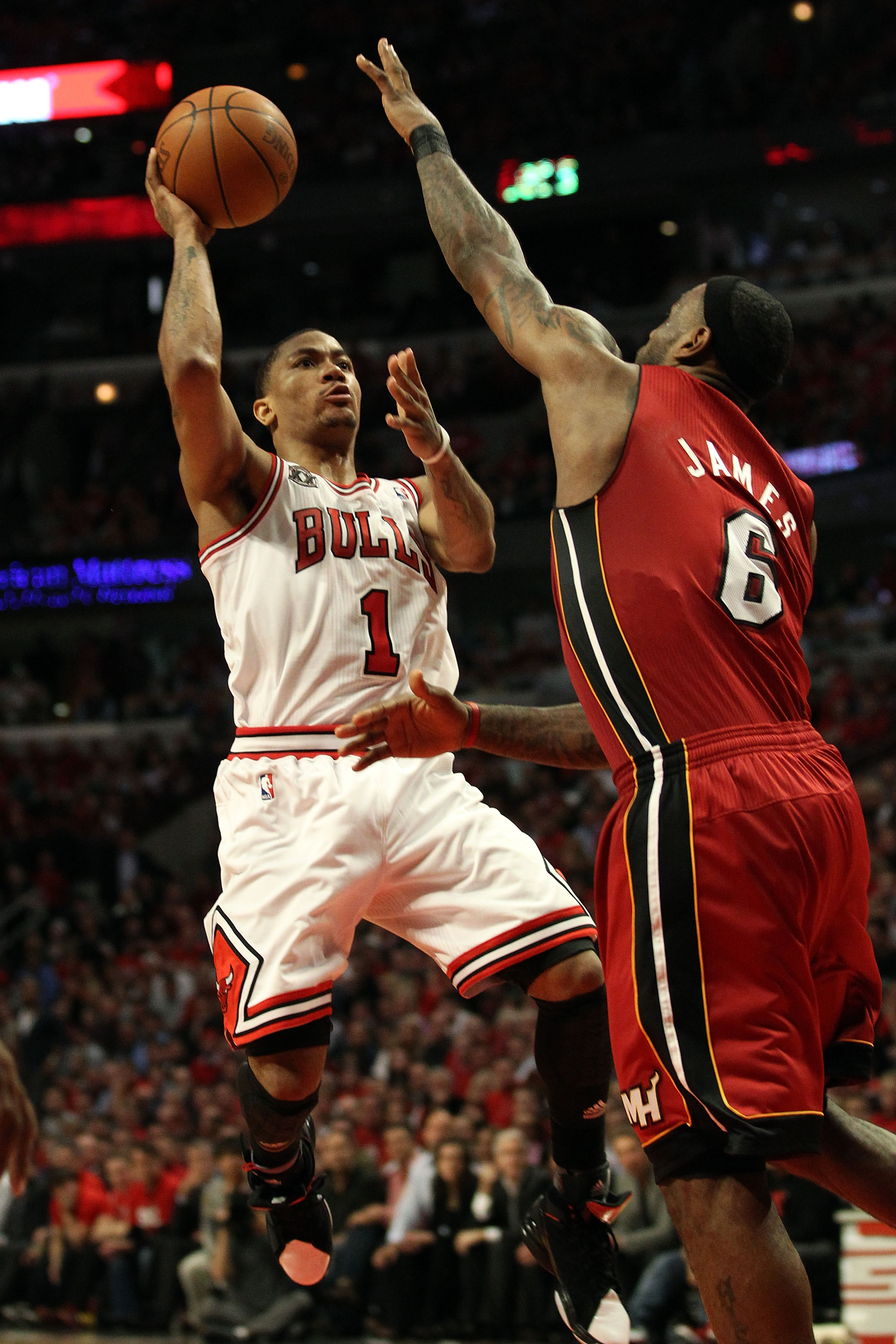 CHICAGO, IL - MAY 26:  Derrick Rose #1 of the Chicago Bulls drives for a shot attempt against LeBron James #6 of the Miami Heat in Game Five of the Eastern Conference Finals during the 2011 NBA Playoffs on May 26, 2011 at the United Center in Chicago, Ill