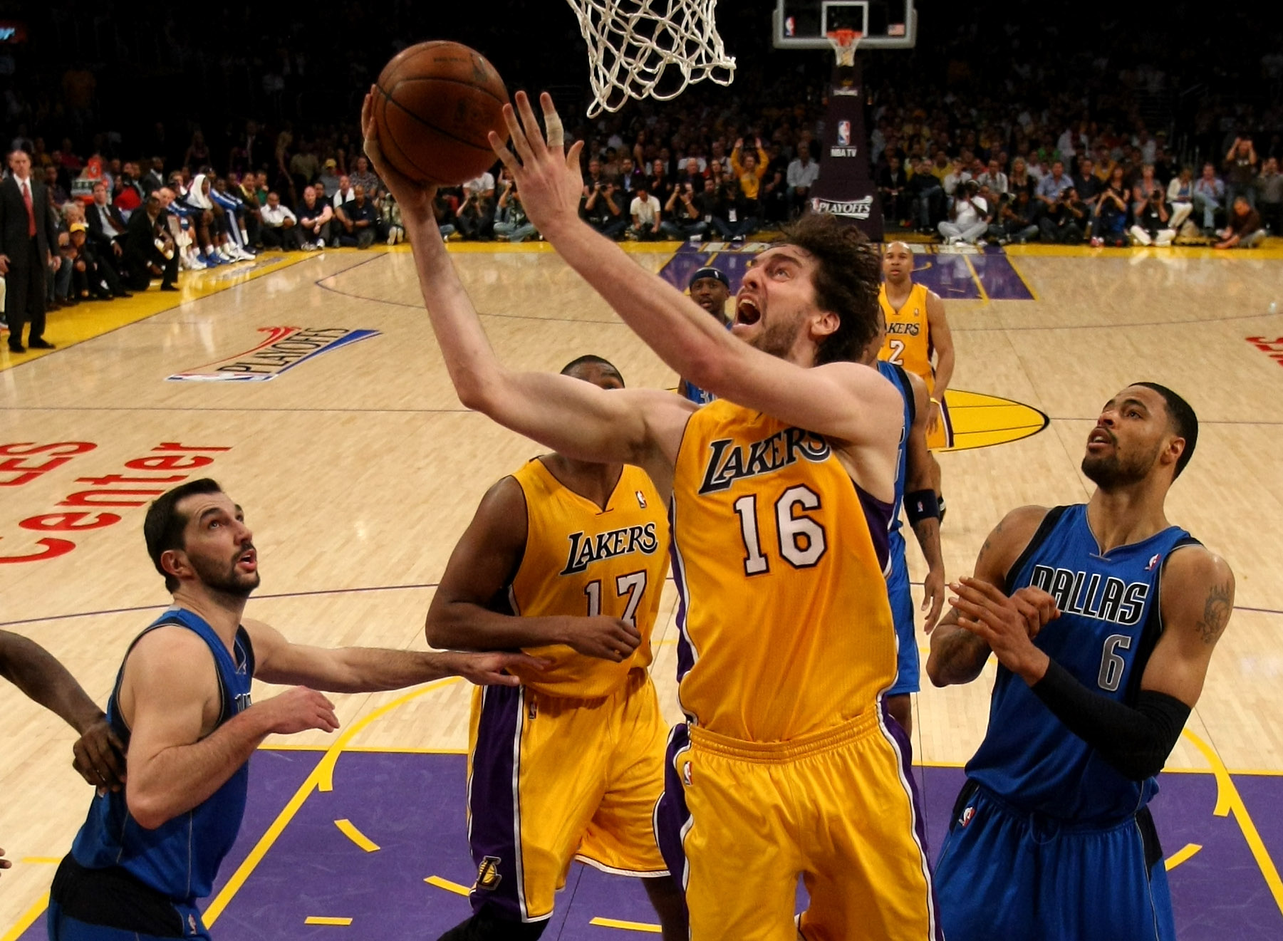 LOS ANGELES, CA - MAY 04:  Pau Gasol #16 of the Los Angeles Lakers goes up for a shot between Peja Stojakovic #16 and Tyson Chandler #6 of the Dallas Mavericks in Game Two of the Western Conference Semifinals in the 2011 NBA Playoffs at Staples Center on