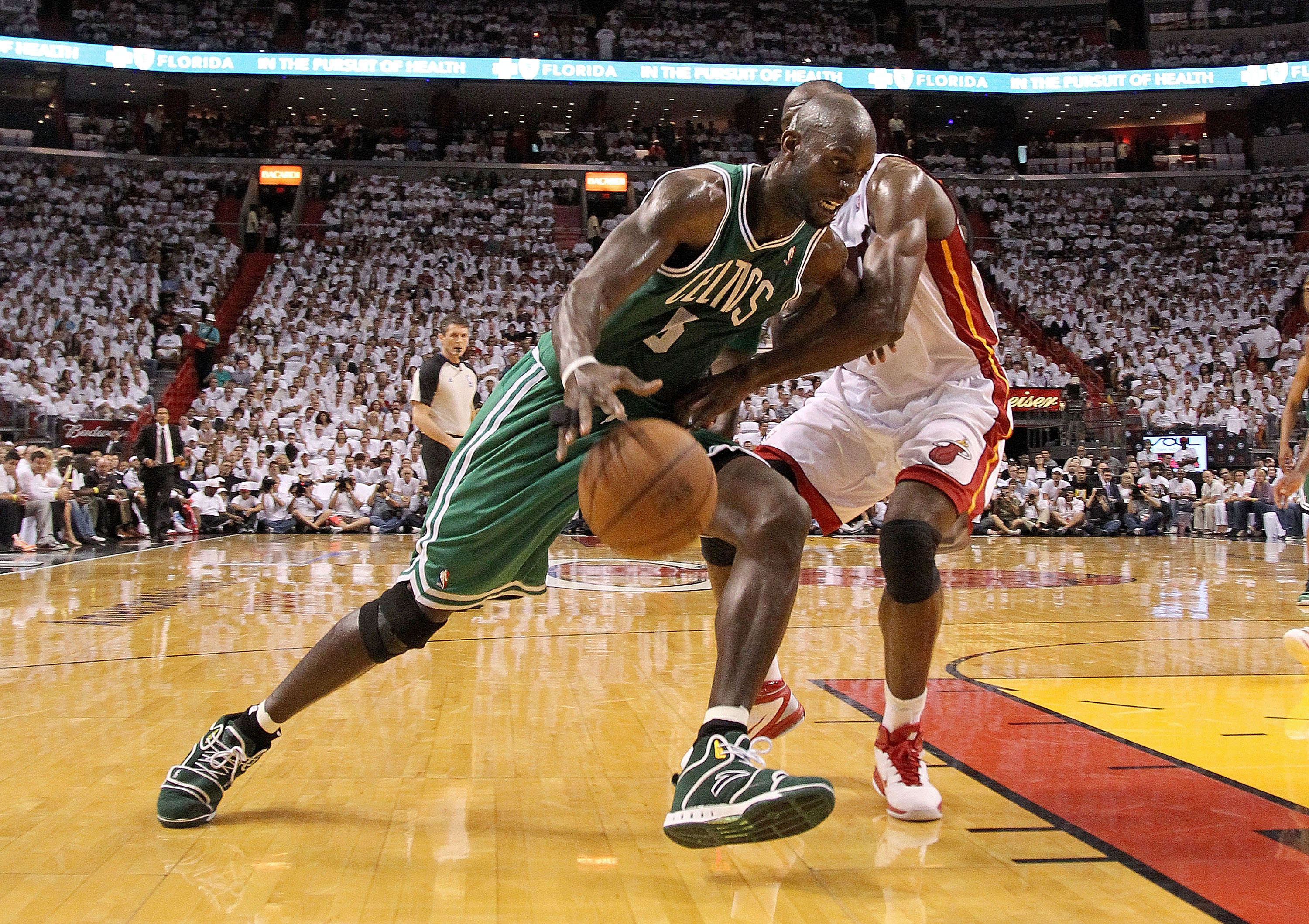 MIAMI, FL - MAY 11: Kevin Garnett #5 of the Boston Celtics drives against Joel Anthony #50 of the Miami Heat during Game Five of the Eastern Conference Semifinals of the 2011 NBA Playoffs at American Airlines Arena on May 11, 2011 in Miami, Florida. NOTE