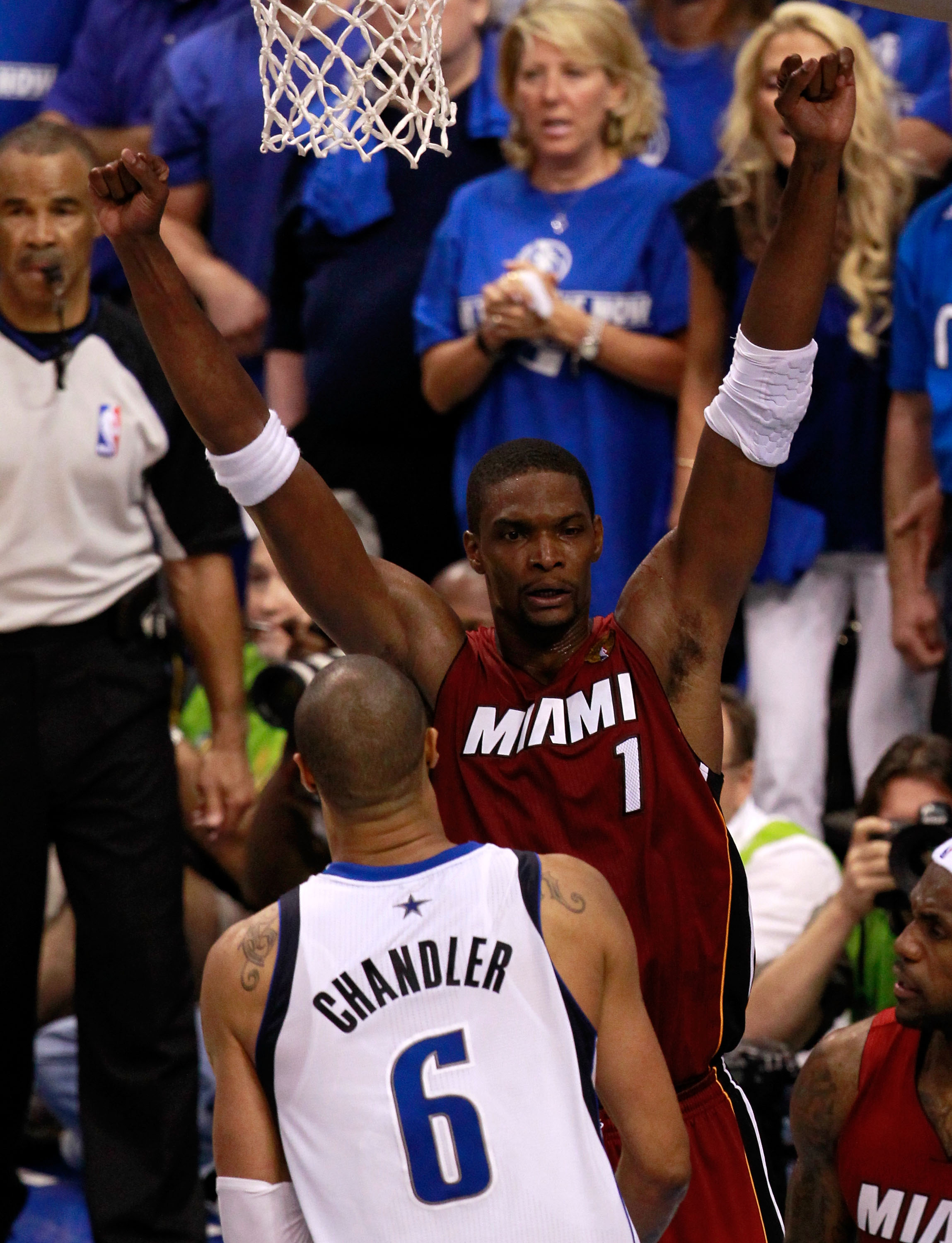 DALLAS, TX - JUNE 05:  Chris Bosh #1 of the Miami Heat celebrates against Tyson Chandler #6 of the Dallas Mavericks after the Heat won 88-86 in Game Three of the 2011 NBA Finals at American Airlines Center on June 5, 2011 in Dallas, Texas.  NOTE TO USER: