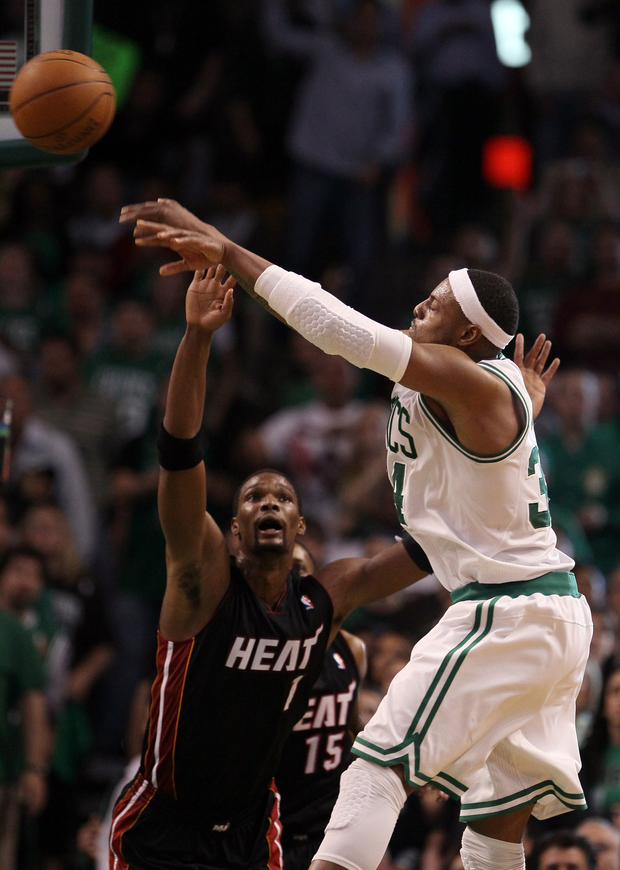 BOSTON, MA - MAY 09:  Paul Pierce #34 of the Boston Celtics passes the ball as Chris Bosh #1 of the Miami Heat defends in Game Four of the Eastern Conference Semifinals in the 2011 NBA Playoffs on May 9, 2011 at the TD Garden in Boston, Massachusetts.  Th