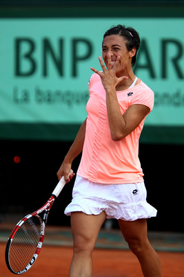 PARIS, FRANCE - JUNE 04:  Francesca Schiavone of Italy reacts during the women's singles final match between Francesca Schiavone of Italy and Na Li of China on day fourteen of the French Open at Roland Garros on June 4, 2011 in Paris, France.  (Photo by C