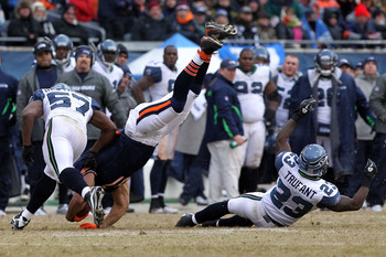 CHICAGO, IL - JANUARY 16:  Kellen Davis #87 of the Chicago Bears flips over after making a catch against David Hawthorne #57 of the Seattle Seahawks in the third quarter of the 2011 NFC divisional playoff game at Soldier Field on January 16, 2011 in Chica