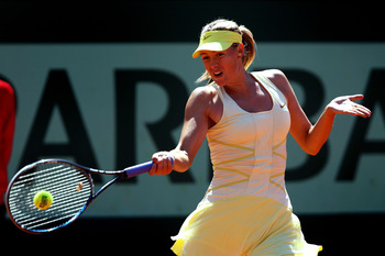PARIS, FRANCE - JUNE 01:  Maria Sharapova of Russia hits a forehand during the women's singles quarterfinal match between Maria Sharapova of Russia and Andrea Petkovic of Germany on day eleven of the French Open at Roland Garros on June 1, 2011 in Paris,