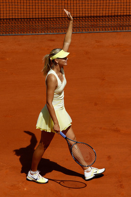 PARIS, FRANCE - MAY 24:  Maria Sharapova of Russia waves to the crowd as she celebrates match point during the women's singles round one match between Maria Sharapova of Russia and Mirjana Lucic of Croatia on day three of the French Open at Roland Garros