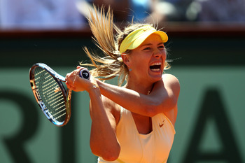 PARIS, FRANCE - JUNE 02:  Maria Sharapova of Russia hits a backhand during the women's singles semi final match between Na Li of China and Maria Sharapova of Russia on day twelve of the French Open at Roland Garros on June 2, 2011 in Paris, France.  (Phot