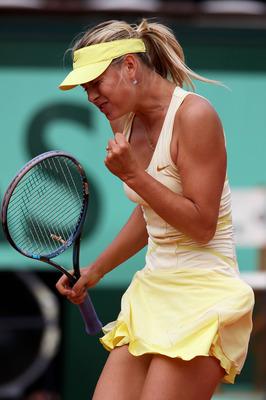 PARIS, FRANCE - MAY 26:  Maria Sharapova of Russia celebrates a point during the women's singles round two match between Maria Sharapova of Russia and Caroline Garcia of France on day five of the French Open at Roland Garros on May 26, 2011 in Paris, Fran