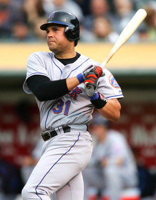 OAKLAND, CA - JUNE 15:  Mike Piazza #31 of the New York Mets doubles against the Oakland Athletics in the second inning during an MLB game on June 15, 2005 at McAfee Coliseum in Oakland, California.  (Photo by Jed Jacobsohn/Getty Images)