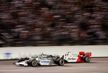 FORT WORTH, TX - JUNE 11:  Tomas Scheckter, driver of the #4 Panther Racing Pennzoil Dallara Chevrolet, beats Sam Hornish Jr., driver of the #6 Marlboro Team Penske Dallara Toyota, to the finish line to win the IRL IndyCar Series Bombardier Learjet 500 on