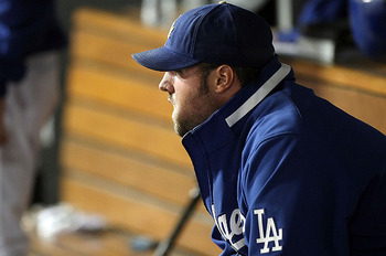 LOS ANGELES, CA - OCTOBER 13:  Jonathan Broxton #51 of the Los Angeles Dodgers sits in the dugout in the ninth inning against the Philadelphia Phillies in Game Four of the National League Championship Series during the 2008 MLB playoffs on October 13, 200