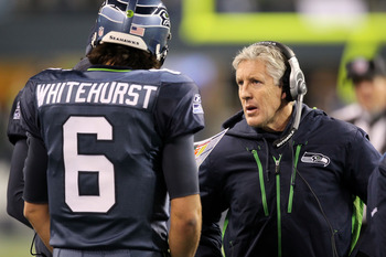 SEATTLE, WA - JANUARY 02:  Head coach Pete Carroll of the Seattle Seahawks talks with quarterback Charlie Whitehurst #6 during their game against the St. Louis Rams at Qwest Field on January 2, 2011 in Seattle, Washington.  (Photo by Otto Greule Jr/Getty