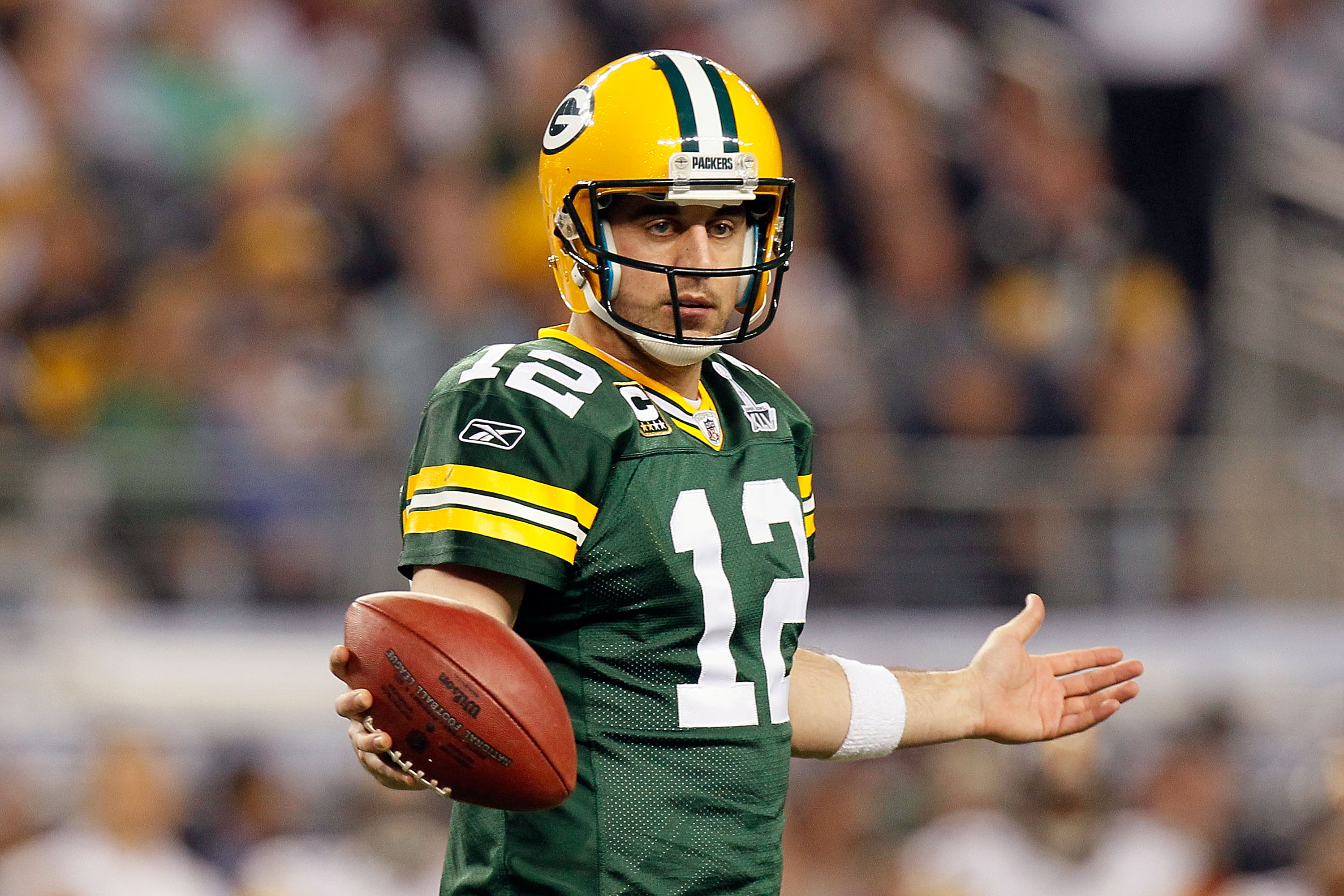 ARLINGTON, TX - FEBRUARY 06: Aaron Rodgers #12 of the Green Bay Packers looks to the sideline during the second half of Super Bowl XLV against the Pittsburgh Steelers at Cowboys Stadium on February 6, 2011 in Arlington, Texas.  (Photo by Kevin C. Cox/Gett