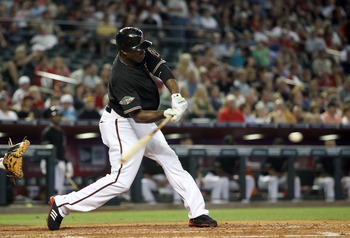 PHOENIX, AZ - JUNE 04:  Justin Upton #10 of the Arizona Diamondbacks hits a single against the Washington Nationals during the fourth inning of the Major League Baseball game at Chase Field on June 4, 2011 in Phoenix, Arizona.  (Photo by Christian Peterse