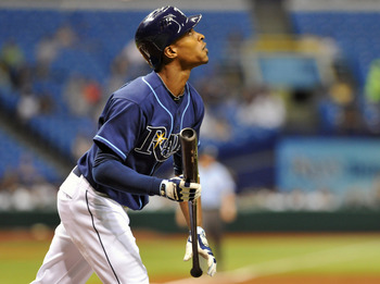 ST. PETERSBURG, FL - JUNE 1:  Outfielder B. J. Upton #2 of the Tampa Bay Rays follows a fly ball against the Texas Rangers June 1, 2011 at Tropicana Field in St. Petersburg, Florida.  (Photo by Al Messerschmidt/Getty Images)