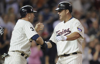 MINNEAPOLIS, MN - MAY 23: Michael Cuddyer #5 and Jim Thome #25 of the Minnesota Twins celebrate Thome's second two-run home run of the game against the Seattle Mariners in the seventh inning of their game on May 16, 2011 at Target Field in Minneapolis, Mi