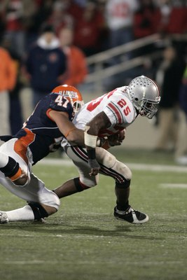 CHAMPAIGN, IL - NOVEMBER 4:  Running back Antonio Pittman #25 of the Ohio State Buckeyes runs with the football as he is tackled by J Leman #47 of the Illinois Fighting Illini in the first half at Memorial Stadium November 4, 2006 in Champaign, Illinois.