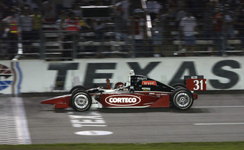 FT. WORTH, TX - JUNE 7:  Al Unser Jr. celebrates as he crosses the finish line to win  the IRL (Indy Racing League) IndyCar Series Bombardier 500 on June 7, 2003 at the Texas Motor Speedway in Ft. Worth, Texas. (Photo by Jonathan Ferrey/Getty Images).