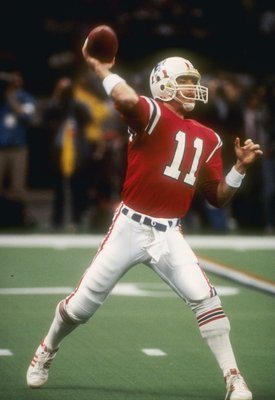 26  Jan 1986:   Quarterback Tony Eason of the New England Patriots tosses the football during the the Super Bowl  XX  game with the Chicago Bears at the Louisiana Superdome in New Orleans, Louisiana.  The Bears won the game, 46-10.   Mandatory Credit: All