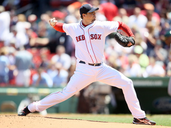 BOSTON, MA - JUNE 04:  Josh Beckett #19 of the Boston Red Sox delivers a pitch in the first inning against the Oakland Athletics on June 4, 2011 at Fenway Park in Boston, Massachusetts.  (Photo by Elsa/Getty Images)